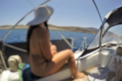 Private skippered yacht charter for naturists in the Greek Cyclades Islands